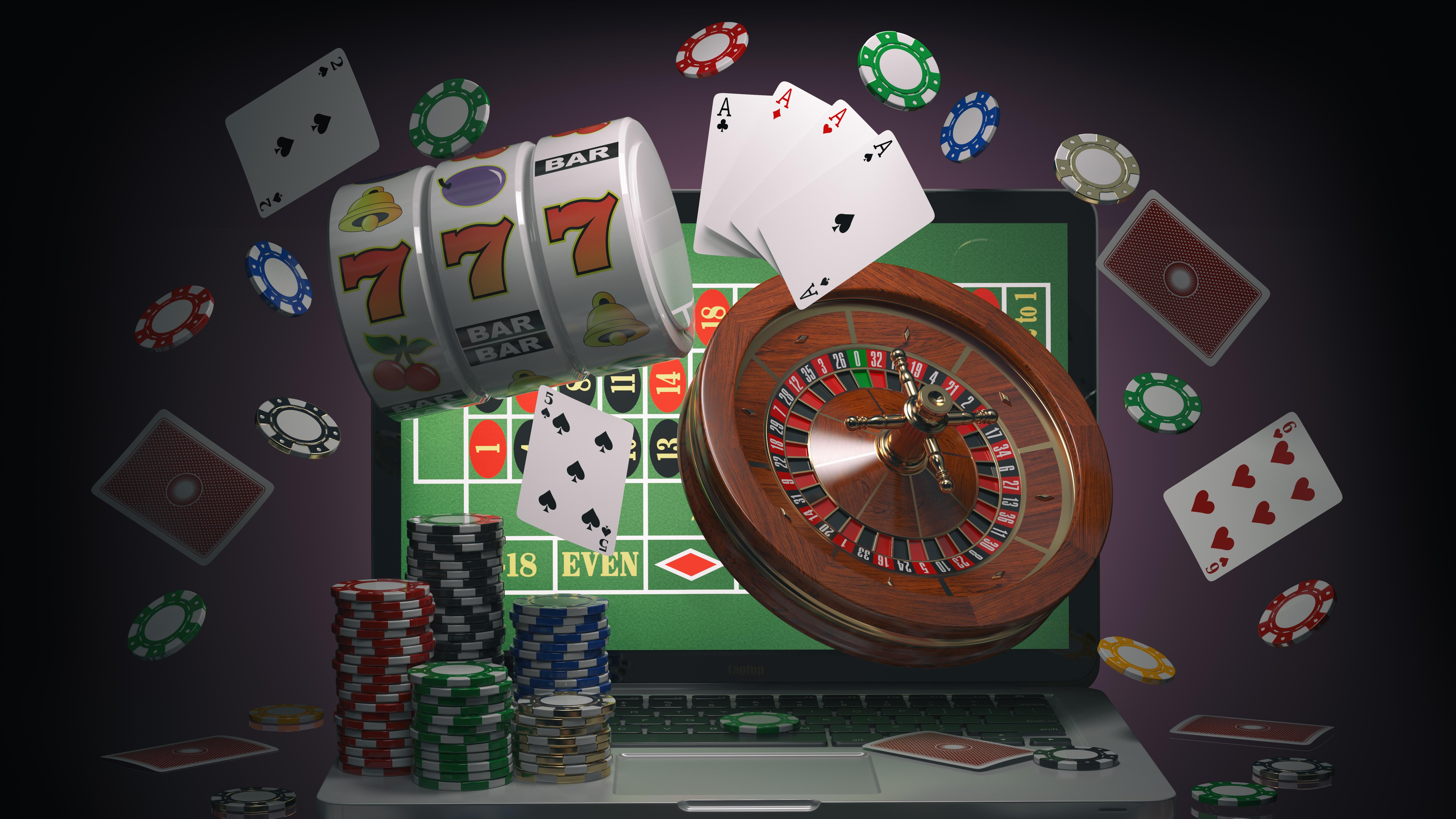 Online Glücksspiel mit Roulete, Spielkarten, Automaten und Pokerchips.