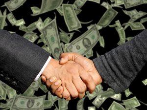 Händeschütteln, Geld