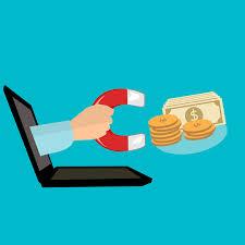 Hand mit Magnet zieht Geld in Laptop