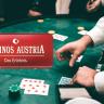 Hände, Spielkarten, Spieltisch, Casinos Austria Logo