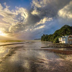 Haus am Meer, Wolken, Sonne