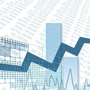 Ein Börsen-Chart und Dollar-Noten